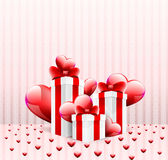 Gift boxes with glossy hearts. Beautiful postcard with glossy hearts, gift boxes and ribbon on a soft background Stock Photos