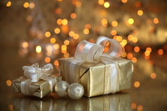 Gift boxes on gold background Stock Image