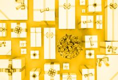 Gift boxes on gold  background. Top view. Gift boxes and flower Stock Photo