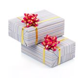 Gift boxes with gold ribbon and pink bow Stock Photos