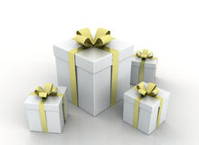 Gift boxes with gold ribbons. Wrapped White gift boxes with gold ribbons and bow Royalty Free Stock Image