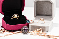Gift boxes with gold rings Royalty Free Stock Images