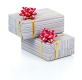 Gift boxes with a gold tape and pink bow Stock Photo