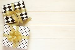 Gift boxes  with golden bow and ribbon Royalty Free Stock Images