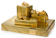 Gift boxes with golden ribbon and wrap. On white background Stock Photo