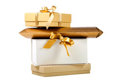 Gift boxes with golden ribbons Royalty Free Stock Photos