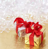 Gift boxes on golden and white background Stock Images