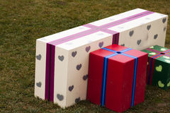 Gift boxes in the grass Stock Photography