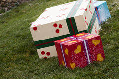 Gift boxes in the grass Royalty Free Stock Photos