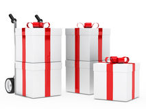 Gift boxes hand truck. Christmas gift box red ribbon hand truck Royalty Free Stock Photography