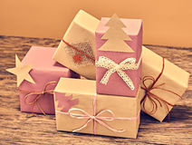 Gift boxes handcraft stack. New Year 2016 on wood Royalty Free Stock Photo