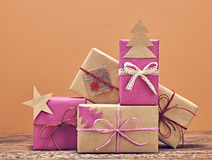 Gift boxes handcraft stack. New Year 2016 on wood royalty free stock photos