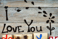 Gift boxes, handmade flower and words I Love You Royalty Free Stock Images