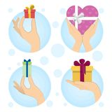 Gift boxes in hands. Royalty Free Stock Images