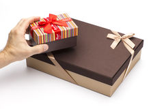 Gift boxes in hands on a white background. Cardboard boxes for packing of gifts Royalty Free Stock Photo