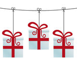 Gift boxes hanging on a twine Stock Image