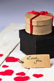 Gift boxes and heart papercut on wooden background Stock Photo