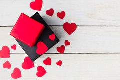 Gift boxes and heart papercut on wooden background Stock Image
