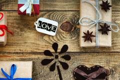 Gift boxes, heart shape and label with word Love Royalty Free Stock Images