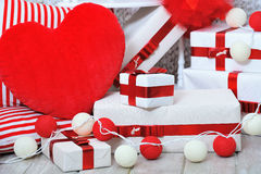 Gift boxes and heart shaped pillow Stock Image