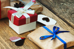 Gift boxes and heart shapes. Gift boxes, heart shapes and anise Royalty Free Stock Images