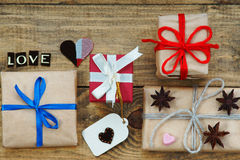 Gift boxes, heart shapes and word Love Royalty Free Stock Images