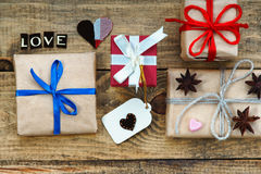 Gift boxes, heart shapes and word Love Stock Photo