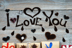 Gift boxes, heart shapes and words I Love You Stock Photo