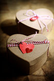 Gift boxes with heart tags Royalty Free Stock Images