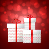 Gift boxes with hearts. Present on Valentine`s Day.  Gift boxes with heart. Red bokeh background. Vector illustration Royalty Free Stock Images