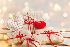 Gift boxes and hearts on white wooden background Royalty Free Stock Image