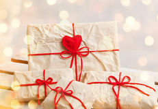 Gift boxes and hearts on white wooden background Royalty Free Stock Photos