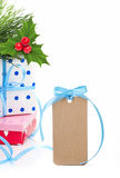 Gift boxes, holly berry and tag Royalty Free Stock Photography