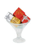 Gift boxes in the ice cream glass bowl on white background Stock Image