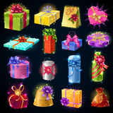 Gift Boxes Icon Set. Cartoon colorful gift boxes icon set isolated and with magic sparkles and bows vector illustration Royalty Free Stock Photography