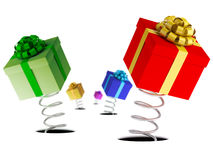 Gift boxes jumping on springs Stock Images