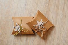 Gift boxes of kraft paper on wooden background Royalty Free Stock Photo
