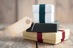 Gift boxes with label Royalty Free Stock Images