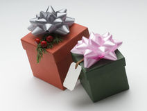 Gift boxes labeled. Two boxes with ribbons and gift tag Stock Images