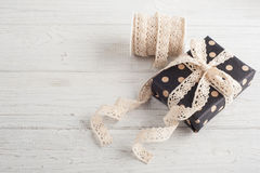 Gift boxes and lace ribbon Royalty Free Stock Photos