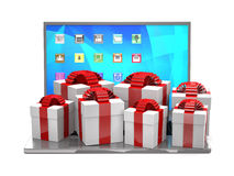 Gift boxes on a laptop keyboard. Royalty Free Stock Image