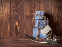 Gift boxes lying on the table Royalty Free Stock Photos