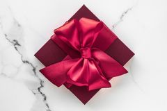 Gift boxes on marble background, holiday flatlay stock photography