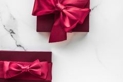 Gift boxes on marble background, holiday flatlay stock photos