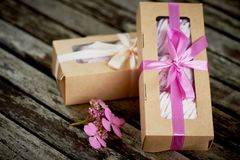 Gift boxes of marshmallows from the confectioner, a compliment.On a wooden background. Romance. Gift boxes of marshmallows from the confectioner, a compliment stock photo