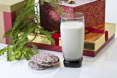 Gift boxes, milk and cookies Stock Images