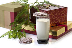 Gift boxes, milk and cookies Stock Photos