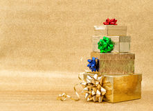 Gift boxes multicolor ribbon bow golden background Holidays Stock Photography