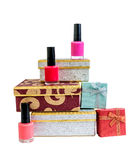 Gift boxes and nail polishes isolated. On white background Stock Images