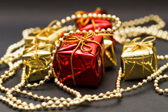 Gift boxes and necklaces Royalty Free Stock Photos